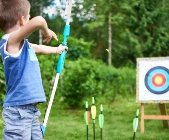 Child shooting bow and arrow